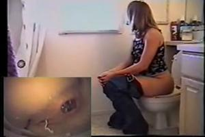 Two cameras in the toilet with pooping girl