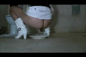 Blonde in white boots pooping in plate