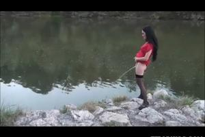 Girl pissing in standing water