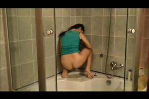 Juliet pooping in the shower