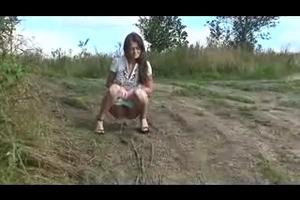 Alenka pee on a rural road