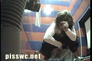 A woman in a white blouse in shit in toilet