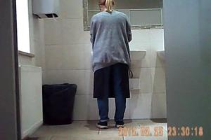Pissing girl. Hidden camera in the toilet