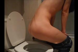 Girl pooping in the toilet, twisting her ass sideways