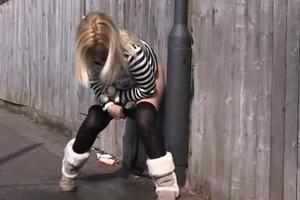 Blonde pissing in the alley