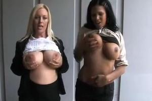 Brunette and blonde rubbing tits