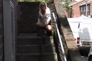 Blonde pissing on the porch