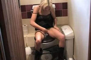 Skinny blonde pissing in toilet