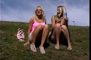 Two blondes pissing on the hill