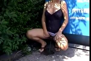 Beautiful blonde pissing on the street