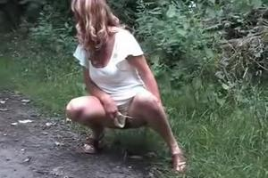 Beth pisses on a footpath