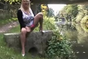 Blonde with huge boobs pissing in the river
