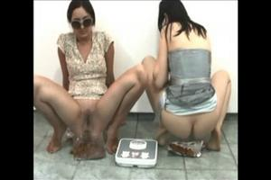 Two brunette pooping