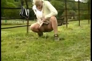 Blonde pisses on the grass