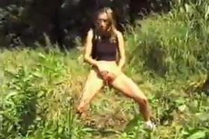 Girl pissing and pooping in the woods