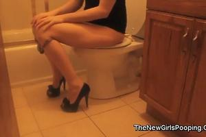 Cutie pooping in the toilet 2