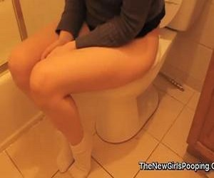 Girl in white socks pooping in the toilet